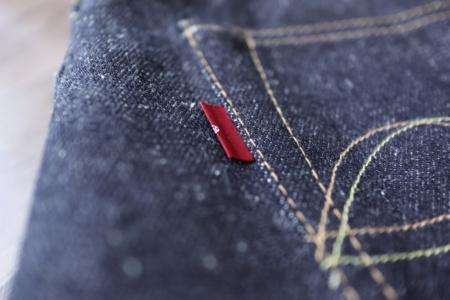 赤タブと銅無垢ボタンをセレクトしたシンプルなCustom bridge